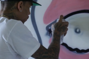 Chris Brown puts his Graffiti talents to use for charity